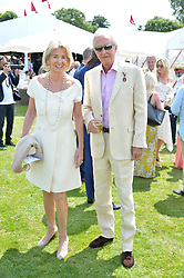 Galen Weston and Hilary Weston at Cartier Queen's Cup Polo, Guard's Polo Club, Berkshire, England. 18 June 2017.