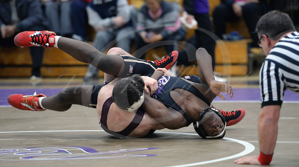 Staff photos by Tom Kelly IV<br /> Garnet Valley's Paul Gartman takes on Upper Darby's Karl Kamanousa in the 152 point match, during the Garnet Valley at Upper Darby wrestling match, Wednesday night, February 4, 2015.