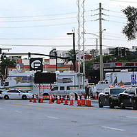 Law enforcement vehicles are seen as they surround the Pulse nightclub where many victims were killed in the deadliest shooting in modern U.S. History on Tuesday, June 14, 2016, in Orlando, Fla. (Alex Menendez via AP)