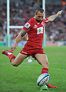 Quade Cooper attempts to convert Will Genia's try ~ Super 15 rugby (Round 15) - Reds v Crusaders played at Suncorp Stadium, Brisbane, Australia on Sunday 29th May 2011 ~ Photo : Steven Hight (AURA Images) / Photosport