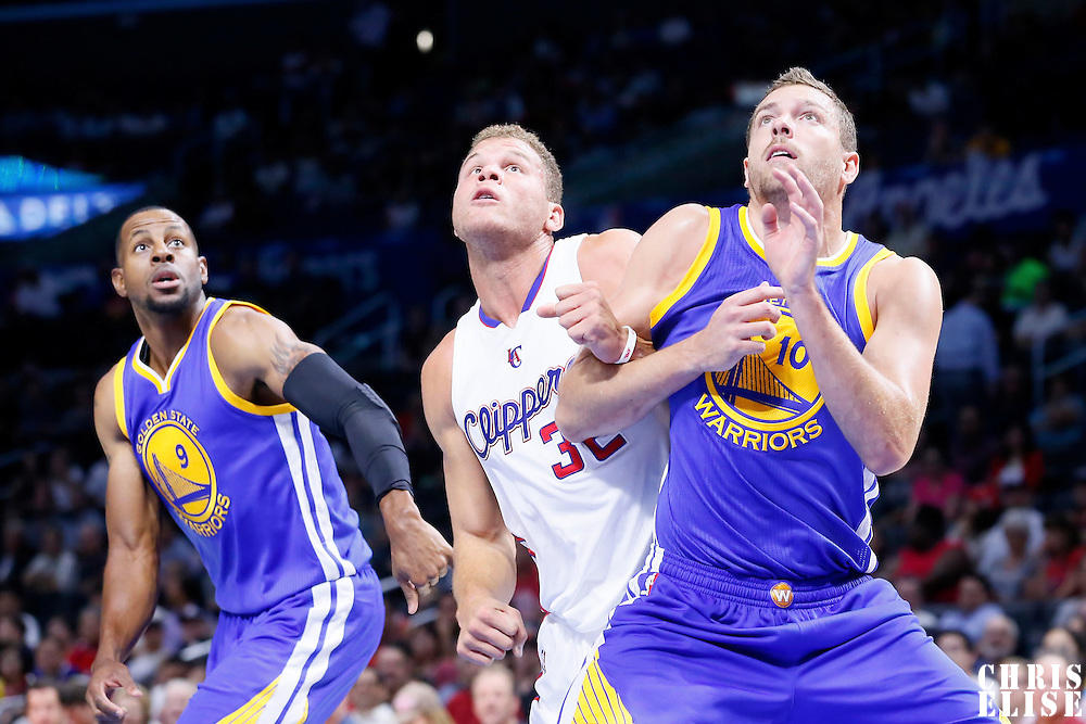 07 October 2014: Los Angeles Clippers forward Blake Griffin (32) vies for the rebound with Golden State Warriors guard Leandro Barbosa (10) and Golden State Warriors guard Andre Iguodala (9) during the Golden State Warriors 112-94 victory over the Los Angeles Clipper, in preseason opener, at the Staples Center, Los Angeles, California, USA.