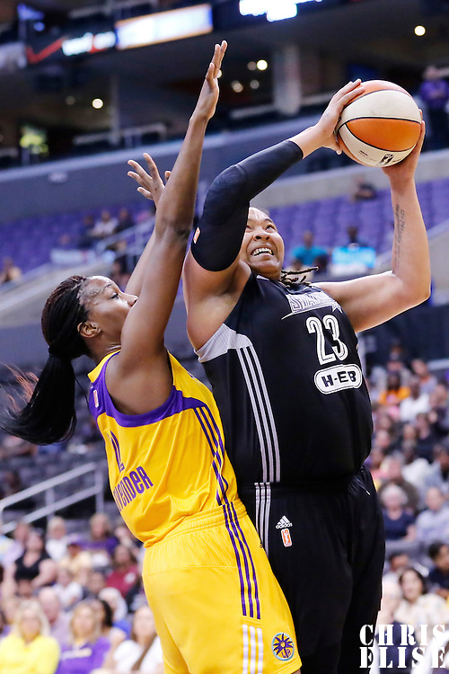 25 May 2014: San Antonio Stars forward/center Danielle Adams (23) goes for the layup past Los Angeles Sparks center Jantel Lavender (42) during the Los Angeles Sparks 83-62 victory over the San Antonio Stars, at the Staples Center, Los Angeles, California, USA.