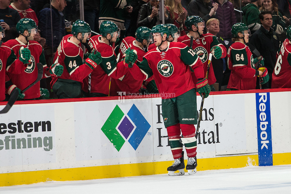 Dec 13, 2016; Saint Paul, MN, USA; Minnesota Wild forward Eric Staal (12) celebrates his goal with teammates during the second period against the Florida Panthers at Xcel Energy Center. Mandatory Credit: Brace Hemmelgarn-USA TODAY Sports