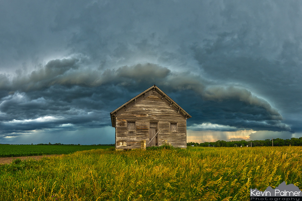An old house sits on the prairie as a storm moves overhead.<br /> <br /> Date Taken: June 21, 2014