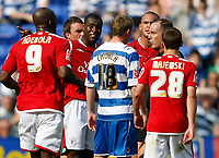 Photo: Steve Bond/Richard Lane Photography. Reading v Nottingham Forest. Coca Cola Championship. 08/08/2009. Ref Phil Crossley surrounded by players after the sending off