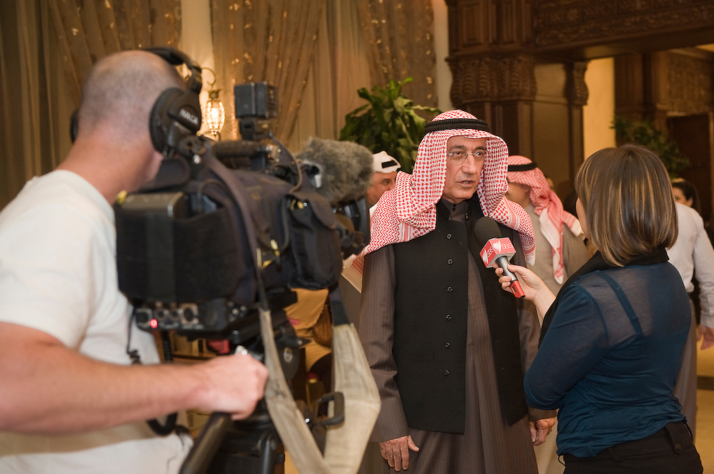 An Austrlian TV crew interviews Dr. Mousa Marafi during a Jan. 29 visit to the Dar Marafi Diwaniya in Kuwait City by foreign media representatives who are in Kuwait to cover the upcoming parliamentary elections. Diwaniyas, an important social institution in Kuwaiti culture, usually comprise an area where guests are welcomed to discuss the latest developments. Some 285 candidates are  running in the elections  to elect a new 50-member parliament.