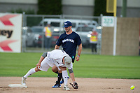 KELOWNA, CANADA - JUNE 28: NHL Dallas Stars player and former Kelowna Rocket reaches second base as second baseman NHL player Montreal Canadiens Brendan Gallagher misses a throw during the opening charity game of the Home Base Slo-Pitch Tournament fundraiser for the Kelowna General Hospital Foundation JoeAnna's House on June 28, 2019 at Elk's Stadium in Kelowna, British Columbia, Canada.  (Photo by Marissa Baecker/Shoot the Breeze)