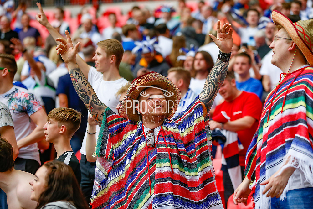 Tranmere Rovers football fans, football supporters celebrates after the EFL Sky Bet League 2 Play Off Final match between Newport County and Tranmere Rovers at Wembley Stadium, London, England on 25 May 2019.
