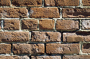 Close up of a weathered brick wall