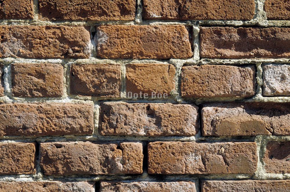 Close up of a weathered brick wall