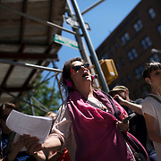 """June 21, 2014 - New York, NY : <br /> The city was flooded with music on Saturday as Make Music New York brought more than 1,300 free concerts to the city's streets and parks. The annual festival's program included """"And Death Shall Have No Dominion,"""" a piece by composer Pete M. Wyer, honoring the centenary of the birth of the poet Dylan Thomas. The piece -- a participatory singing event -- was performed by a synchronized headphone choir. The choir's singers began in smaller groups around lower Manhattan and culminated in a meeting in Battery Park City. The sopranos, who began their walk at Bleecker Playground in Greenwich Village, sing as they make their way to the meeting point in Nelson A. Rockefeller Park. Singing, in foreground, are Regina Kelly, center, and Pamela Cook, right.  CREDIT: Karsten Moran for The New York Times"""
