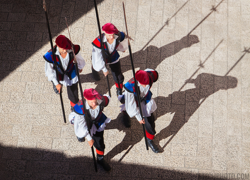 A bird's eye view of traditional soldiers marching and the changing of the guard in the old city of Dubrovnik, Croatia.<br />