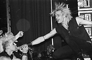 Punk in crowd singing into microphone at a GBH gig, UK, 1980s