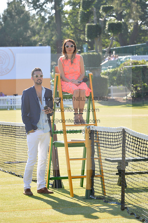 HUGO TAYLOR and JULIET ANGUS at the Summer Solstice Party during the Boodles Tennis event hosted by Beulah London and Taylor Morris at Stoke Park, Park Road, Stoke Poges, Buckinghamshire on 21st June 2014.
