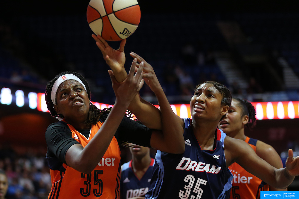 UNCASVILLE, CONNECTICUT- JUNE 3:   Jonquel Jones #35 of the Connecticut Sun and Angel McCoughtry #35 of the Atlanta Dream challenge for a rebound during the Atlanta Dream Vs Connecticut Sun, WNBA regular season game at Mohegan Sun Arena on June 3, 2016 in Uncasville, Connecticut. (Photo by Tim Clayton/Corbis via Getty Images)