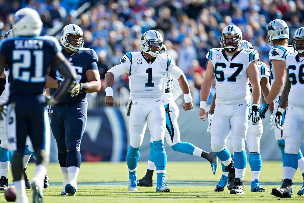 NASHVILLE, TN - NOVEMBER 15:  Cam Newton #1 of the Carolina Panthers signals the next play while walking up to the line of scrimmage during a game against the Tennessee Titans at Nissan Stadium on November 15, 2015 in Nashville, Tennessee.  (Photo by Wesley Hitt/Getty Images) *** Local Caption *** Cam Newton