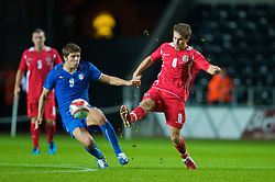 SWANSEA, ENGLAND - Friday, September 4, 2009: Wales' Aaron Ramsey and Italy's Alberto Paloschi during the UEFA Under 21 Championship Qualifying Group 3 match at the Liberty Stadium. (Photo by David Rawcliffe/Propaganda)