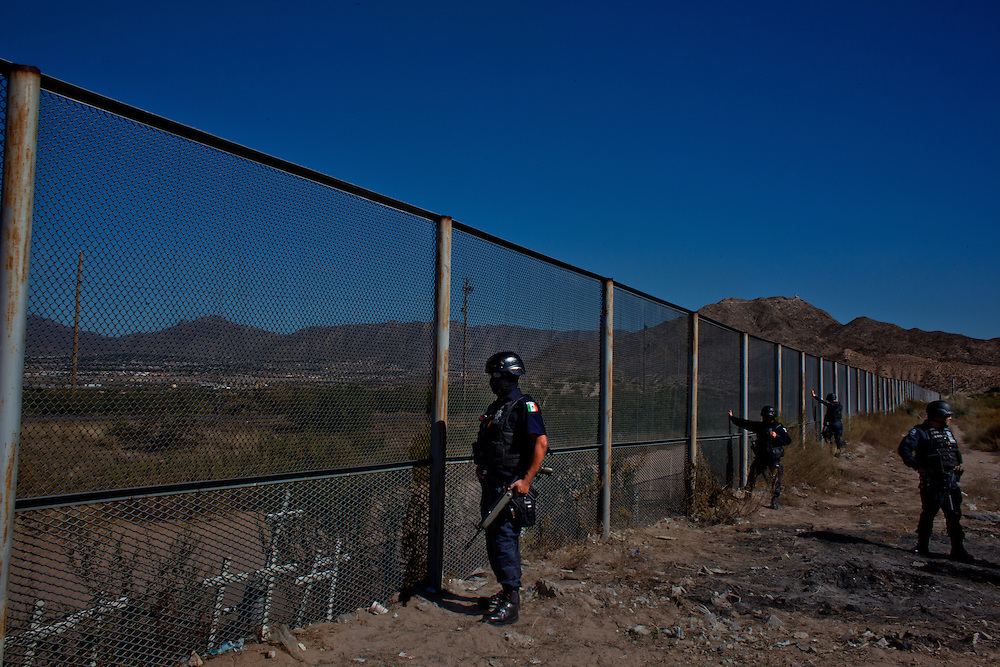 Mexican Federal Police patrol near the United States and Mexican border in the colonia Anapra of Ciudad Juarez.