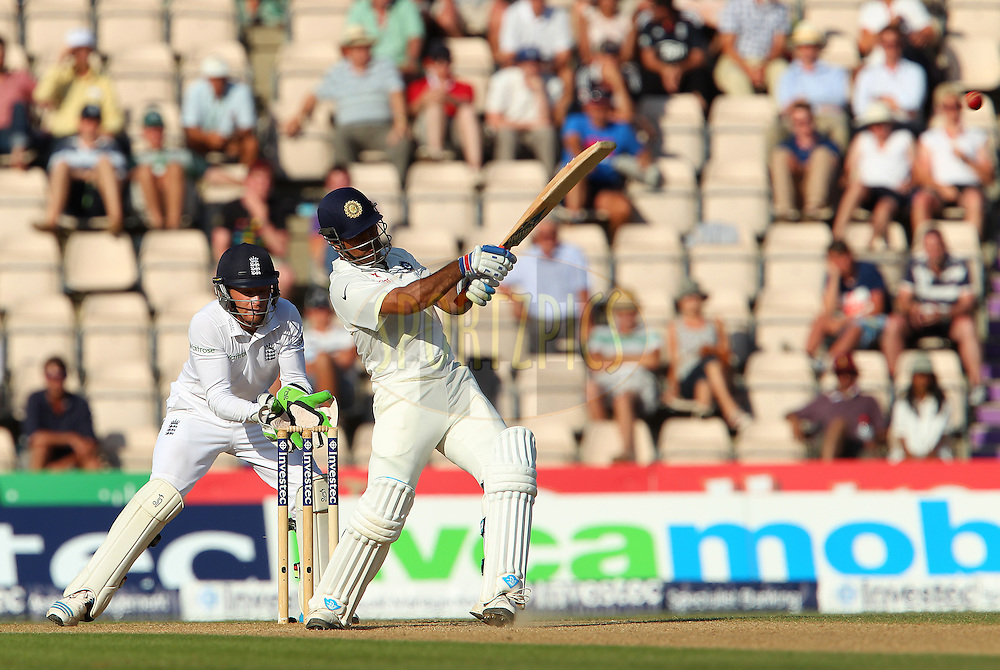 Mahendra Singh Dhoni captain of India pulls a four during day three of the third Investec Test Match between England and India held at The Ageas Bowl cricket ground in Southampton, England on the 29th July 2014<br /> <br /> Photo by Ron Gaunt / SPORTZPICS/ BCCI