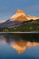 Dawn over Mount Wilbur 9,321 ft (2,841 m) and Swiftcurrent Lake, Glacier National Park Montana USA