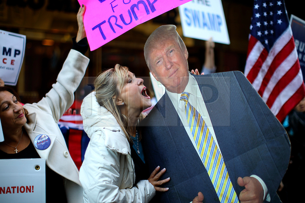© Licensed to London News Pictures. 07/11/2016. New York CIty, USA. A Donald Trump and Republican supporter kisses a cut-out of Presidential candidate Donald Trump outside Trump Tower in New York City on Monday, 7 November, the day before the presidential election day in the United States of America. Photo credit: Tolga Akmen/LNP