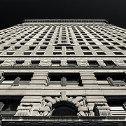 Monotone abstract facade of the Flatiron building in New York City.