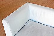 white leather bench corner