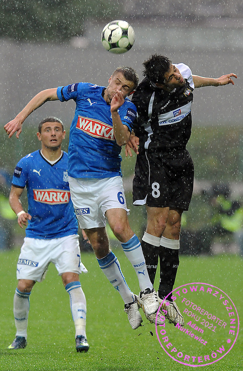 (L) TOMASZ BANDROWSKI (LECH POZNAN) & (R) FILIP IVANOVSKI (POLONIA WARSZAWA) DURING SEMI FINAL POLISH CUP SOCCER MATCH BETWEEN POLONIA WARSZAWA AND LECH POZNAN IN SEASON 2008/2009...WARSAW, POLAND , MAY 06, 2009..( PHOTO BY ADAM NURKIEWICZ / MEDIASPORT )..PICTURE ALSO AVAIBLE IN RAW OR TIFF FORMAT ON SPECIAL REQUEST.