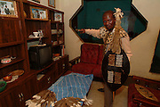 Masimuli - Wiseman- Mtembe, the Zulu Indunu (commander) at home the night before the battle preparing his costume. Isandlwana. Zululand..©Zute Lightfoot.DVD0018.