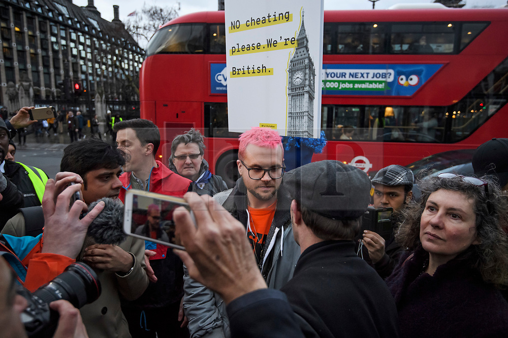 © Licensed to London News Pictures. 29/03/2018. London, UK. Cambridge Analytica whittleblower CHRISTOPHER WYLIE (centre, pink hair) joins a demonstration held by Fair Vote, outside the Houses of Parliament in London, calling for a fair vote on the EU referendum. Whistleblowers Shahmir Sanni and Christopher Wylie both spoke at the event attended by a small number of people.. Photo credit: Ben Cawthra/LNP