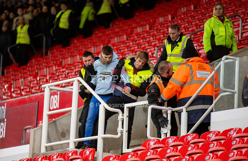 STOKE-ON-TRENT, ENGLAND - Saturday, January 25, 2020: A Swansea City supporter is manhandled by stewards during the Football League Championship match between Stoke City FC and Swansea City FC at the Britannia Stadium. (Pic by David Rawcliffe/Propaganda)