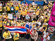 "22 JUNE 2011 - BANGKOK, THAILAND: Thai Yellow Shirts call for a no vote during a pre-election rally in Bangkok on Wednesday, June 22. The PAD (People's Alliance for Democracy) or Yellow Shirts, as they are popularly called, has called for a ""No"" vote in Thailand's national election, scheduled for July 3. PAD leadership hopes the no vote will negate the vote of Yingluck Shinawatra, leader of the Pheua Thai party. Yingluck is the youngest sister of exiled former Prime Minister Thaksin Shinawatra, deposed by a military coup in 2006. Yingluck is currently leading in opinion polls, running well ahead of incumbent Prime Minister Abhisit Vejjajiva, head of the Democrat party, which in one form or another has ruled Thailand for most of the last 60 years.     Photo by Jack Kurtz"