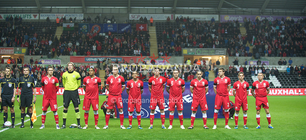SWANSEA, WALES - Friday, October 7, 2011: Wales players line-up to face Switzerland during the UEFA Euro 2012 Qualifying Group G match at the Liberty Stadium. L-R: captain Aaron Ramsey, goalkeeper Wayne Hennessey, Ashley Williams, Steve Morison, Neil Taylor, Gareth Bale, Darcy Blake, Andrew Crofts, Chris Gunter, Joe Allen, Craig Bellamy. (Pic by David Rawcliffe/Propaganda)