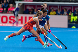 The Netherlands Xan de Waard is tackled by Dalila Mirabella of Italy. The Netherlands v Italy - Vitality Hockey Women's World Cup, Lee Valley Hockey and Tennis Centre, London, UK on 29 July 2018. Photo: Simon Parker