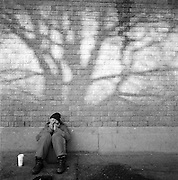 Homeless man in Anchorage, Alaska playing the harmonica. 2008