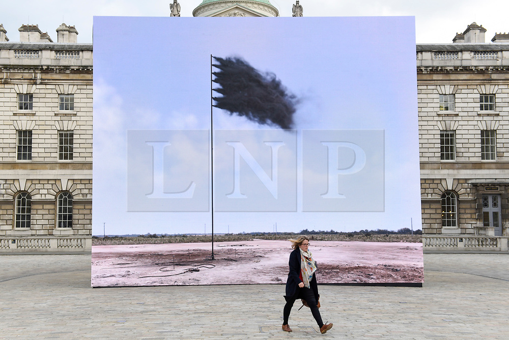 "© Licensed to London News Pictures. 20/04/2017. London, UK. Unveiling at Somerset House of ""Western Flag"" (Spindletop, Texas) 2017 by artist John Gerrard.  The artwork, in the form of an LED wall installation, is a symbol for climate change and modern society's dependence on oil and has been commissioned by Channel 4 as part of their Man-Made Planet season to mark this year's Earth Day (22nd April).   Photo credit : Stephen Chung/LNP"