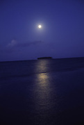 Moonset over Mutu (island), Raiatea, French Polynesia<br />
