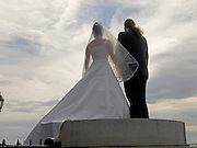 couple in wedding attire standing on top of a