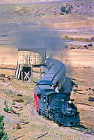 Cumbres & Toltec Scenic Railroad.  Westbound train passes by the Los Pinos Water Tank.  The picturesque tank was built in 1880.