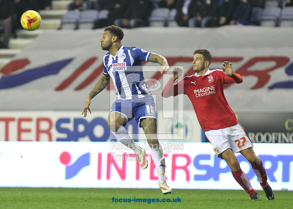 Craig Davies of Wigan Athletic and Bradley Barry of Swindon Town during the Sky Bet League 1 match at the DW Stadium, Wigan.<br /> Picture by Michael Sedgwick/Focus Images Ltd +44 7900 363072<br /> 31/10/2015