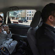 "WASHINGTON, DC - APR 4:  Sophie Ye Tao, an investment banker from China, takes an UberX with driver Sanjiv Kumar, April 9, 2014, in Washington, DC. Thousands of local car owners have signed up in recent months to drive with one of the ""ride-share"" operators that use smartphone apps to link people needing rides with car owners willing to give them, for a price. (Photo by Evelyn Hockstein/For The Washington Post)"