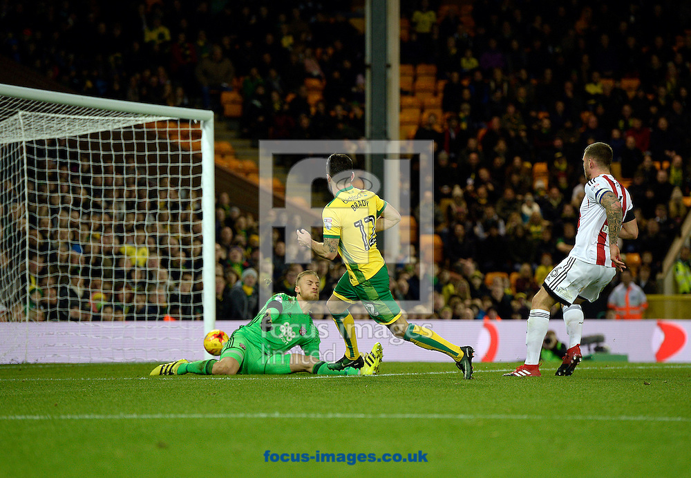 Robbie Brady of Norwich City scores past Daniel Bentley of Brentford for the third goal, during the Sky Bet Championship match at Carrow Road, Norwich<br /> Picture by Matthew Usher/Focus Images Ltd +44 7902 242054<br /> 03/12/2016