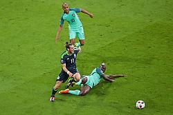 LYON, FRANCE - Wednesday, July 6, 2016: Wales' Gareth Bale in action against Portugal's Danilo Luiz da Silva during the UEFA Euro 2016 Championship Semi-Final match at the Stade de Lyon. (Pic by Paul Greenwood/Propaganda)