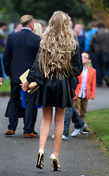© Licensed to London News Pictures. 26/10/2017. Epsom, UK. A young woman in high heels leaves the funeral of Tom 'Tomboy' Doherty the nephew of Big Fat Gypsy Weddings star Paddy Doherty, at Epsom Cemetery in Epsom, Surrey. Tom Doherty was 17 when he was killed in a car crash in South Nutfield in Surrey on October 9. He had passed his driving test just days earlier. Photo credit: Ben Cawthra/LNP