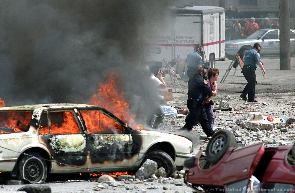 A Seattle police officer helps victims during a mock terrorist attack south of downtown on Monday, May 12, 2003 in Seattle, Washington. Controllers set off an explosion shortly after noon which simulated the detonation of a radioactive dispersal device or 'dirty bomb.'