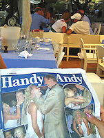 **EXCLUSIVE**.A person on the table next to the Duchess of York, Sarah Ferguson, reading and article about her ex husband, Prince Andrew and Chris on Aspen on the Mail on Sunday, while she flirts with an indentify man.Club 55 Restaurant .St. Tropez, France..Sunday, July 29, 2007.Photo By Celebrityvibe.com.To license this image please call (212) 410 5354; or.Email: celebrityvibe@gmail.com ;.