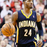 02 December 2013: Indiana Pacers small forward Paul George (24) brings the ball upcourt during the Portland Trail Blazers 106-102 victory over the Indiana Pacers at the Moda Center, Portland, Oregon, USA.