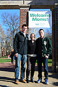 Corrine, Branden, and Taylor Henning pose for a picture outside college green at Ohio University during Mom's Weekend.