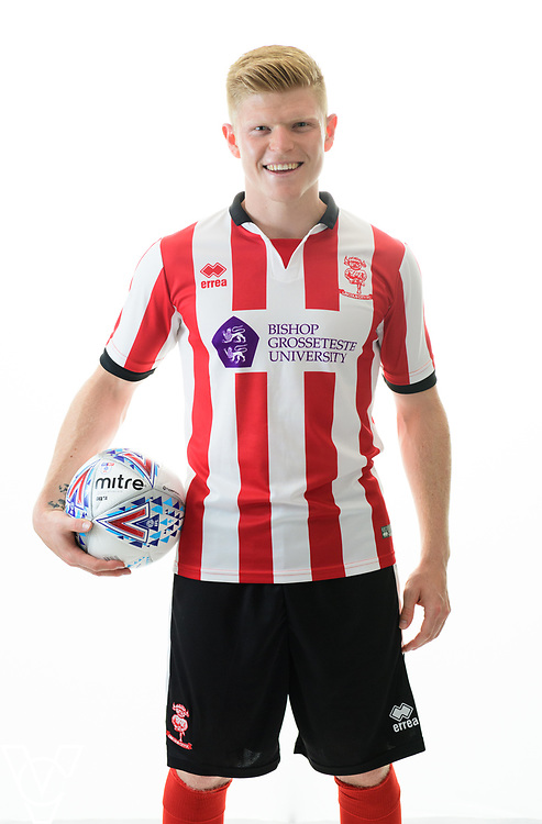 Lincoln City Football Club kit launch ahead of the 2017/18 EFL Sky Bet League Two season.  Pictured is Lincoln City's Elliott Whitehouse wearing the red and white Errea home shirt, with the Bishop Grosseteste University logo on the front.<br /> <br /> Picture: Chris Vaughan Photography<br /> Date: June 19, 2017