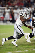 Oakland Raiders rookie linebacker Shilique Calhoun (91) chases the action during the 2016 NFL preseason football game against the Arizona Cardinals on Friday, Aug. 12, 2016 in Glendale, Ariz. The Raiders won the game 31-10. (©Paul Anthony Spinelli)